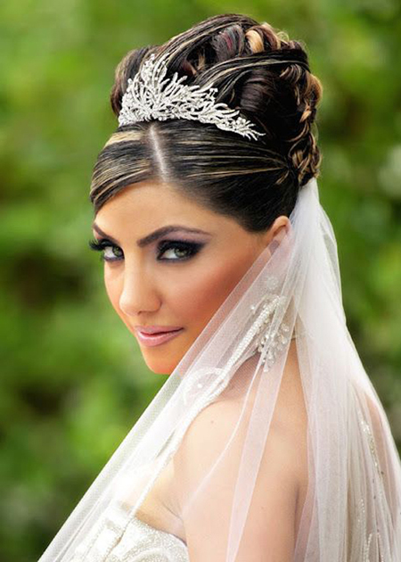 Bridal Hairstyle With Veil And Tiara On A High Bun