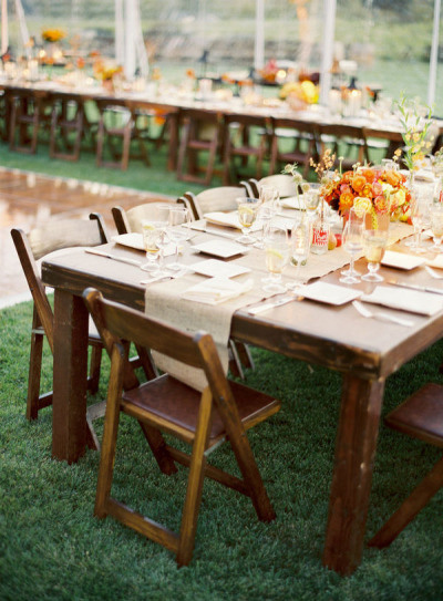 Wooden chairs tables for a woodland wedding