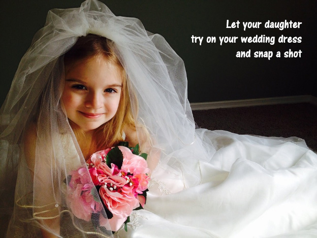 Let your daughter try on your wedding dress and snap a shot